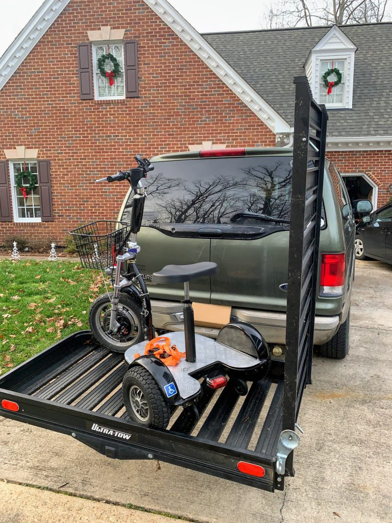 Triad Mobility Scooter angled on carrier and ready to be secured